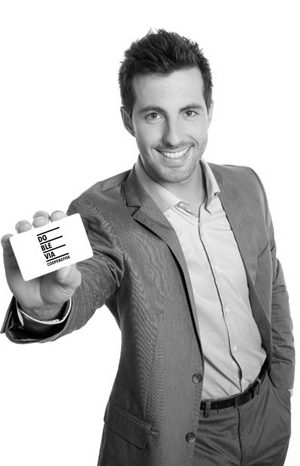 Successful businessman showing business card